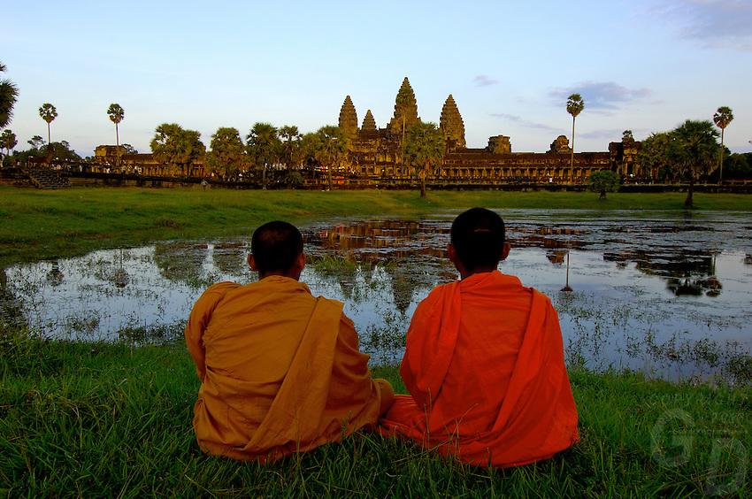 Buddhist Monks watching the Sunset at Angkor Wat,Cambodia
