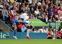 Pictured L-R: Brede Hangeland of Crystal Palace challenges Bafetimbi Gomis of Swansea<br />