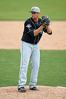 Lansing Lugnuts relief pitcher Dan Lietz (20) gets ready to deliver a pitch during a game against the Clinton LumberKings on May 9, 2017 at Ashford University Field in Clinton, Iowa.  Lansing defeated Clinton 11-6.  (Mike Janes/Four Seam Images)