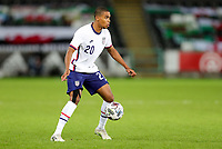SWANSEA, WALES - NOVEMBER 12: Reggie Cannon #20 of the United States moves with the ball during a game between Wales and USMNT at Liberty Stadium on November 12, 2020 in Swansea, Wales.