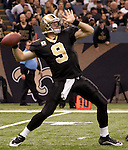 December 2009: New Orleans Saints quarterback Drew Brees (9) passes the ball during an NFL football game at the Louisiana Superdome in New Orleans.