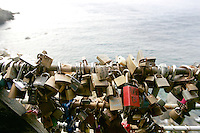 "Lucchetti su una balaustra lungo la Via dell'Amore tra Riomaggiore e Manarola, alle Cinque Terre.<br /> Padlocks hanged on a balustrade along the Via dell'Amore (Love Street) at the Cinque Terre. In late 2006, Rome's Ponte Milvio bridge began attracting couples, who use a lamppost on the bridge to hang padlocks as a sign of their love. The ritual involves the couple locking the padlock to the lamppost, then throwing the key behind them into the Tiber, emulating the bestseller (and movie) ""Three steps over heaven"" by the writer Federico Moccia. .<br /> UPDATE IMAGES PRESS/Riccardo De Luca"