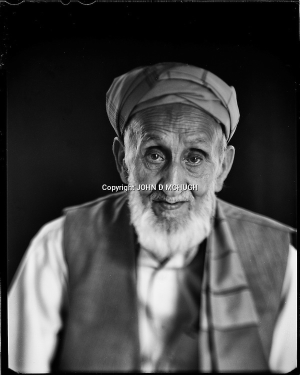 "Abdulhadi, 83, a woodcarver and teacher, is seen at the Turquoise Mountain Foundation in Kabul, 26 August 2012. This portrait was shot on a 5x4 Linhof Technika IV, circa 1959, and a Schneider Kreuznach 270mm lens, circa 1952, with front tilt, and is part of a series entitled ""Putting an Afghan face on the war."" (John D McHugh)"