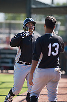 Chicago White Sox first baseman Harvin Mendoza (23) is congratulated by Lenyn Sosa (13) after hitting a home run during an Instructional League game against the Oakland Athletics at Lew Wolff Training Complex on October 5, 2018 in Mesa, Arizona. (Zachary Lucy/Four Seam Images)