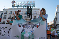 MADRID, SPAIN - JUNE 29: Health workers applauding during a protest held in the afternoon in Puerta del Sol to request better working conditions, protection equipment and investment in Health to fight against the covid-19 on June 29 2020, in Madrid, Spain. The region of Madrid was the main focus of covid-19 outbreak in Spain. In al over the country, more than 50000 thousand health staff has been infected with the coronavirus since the beginning of the pandemic.(Photo by Sergio Belena/VIEWpress via Getty Images).