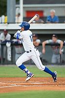 Jeison Guzman (13) of the Burlington Royals follows through on his swing against the Danville Braves at Burlington Athletic Stadium on August 12, 2017 in Burlington, North Carolina.  The Braves defeated the Royals 5-3.  (Brian Westerholt/Four Seam Images)