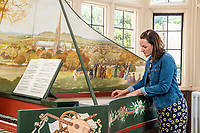 BNPS.co.uk (01202 558833)<br /> Pic: MaxWillcock/BNPS<br /> <br /> Pictured: The Salisbury Museum's Natasha Clayton playing the harpsichord.<br /> <br /> A one a kind harpsichord on display in the Ceramics Gallery at The Salisbury Museum has undergone a restoration after it was repainted by Diana de Vere Cole. She painted flowers and ribbons along the sides, adding to the artwork she had previously painted.<br /> <br /> This harpsichord was made by the late James Mogford of St Ann Street in Salisbury in 1984, and the painting of Salisbury Cathedral was then added by Diana de Vere Cole.<br /> <br /> The painting on the inside of the lid depicts a scene of people playing music in a field with Salisbury Cathedral in the background.