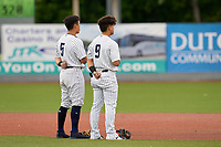 Hudson Valley Renegades shortstop Anthony Volpe (5) and second baseman Eduardo Torrealba (9) stand for the national anthem before a game against the Brooklyn Cyclones on September 12, 2021 at Dutchess Stadium in Fishkill, New York.  (Mike Janes/Four Seam Images)