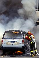 Fireman puts out car fire