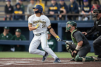 Michigan Wolverines outfielder Jordan Brewer (22) follows through on his swing in the NCAA baseball game against the Michigan State Spartans on May 7, 2019 at Ray Fisher Stadium in Ann Arbor, Michigan. Michigan defeated Michigan State 7-0. (Andrew Woolley/Four Seam Images)