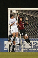 New York Power goalkeeper Gao Hong makes a save against Birgit Prinz of the Carolina Courage during the Power's 3-2 loss on June 26th at Mitchel athletic Complex.