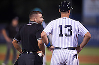Umpire Jonathan Parra talks with manager Pat Osborn (13) during a game between the Daytona Tortugas and Tampa Yankees on August 5, 2016 at George M. Steinbrenner Field in Tampa, Florida.  Tampa defeated Daytona 7-1.  (Mike Janes/Four Seam Images)