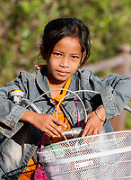 Cambodia, Banteay Srei.  Little Girl on her Bicycle.