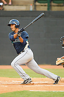 Jose Rivero #58 of the Pulaski Mariners follows through on his swing against the Bristol White Sox at Boyce Cox Field August 28, 2010, in Bristol, Tennessee.  Photo by Brian Westerholt / Four Seam Images