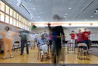 USA, Nebraska, Omaha, Tai-Chi for senior citizen, blurred due to long time exposure
