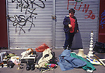 Child poverty 1990s London, Notting Hill child selling off family stuff to make ends meet.1999.