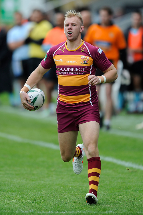 Aaron Murphy of Huddersfield Giants runs in a try during the Super League match between Huddersfield Giants and London Broncos at The Twickenham Stoop on Saturday 17th August 2013 (Photo by Rob Munro)