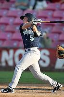 Eugene Emeralds infielder Clint Moore #5 bats against the Salem-Keizer Volcanoes at Volcanoes Stadium on August 9, 2011 in Salem-Keizer,Oregon. Eugene defeated Salem-Keizer 13-7.(Larry Goren/Four Seam Images)