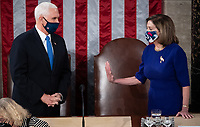 US Speaker of the House Nancy Pelosi speaks with US Vice President Mike Pence as he presides over a joint session of Congress to count the electoral votes for President at the US Capitol in Washington, DC, January 6, 2021.<br /> Credit: Saul Loeb / Pool via CNP/AdMedia