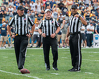 Big Ten football officials meet including Umpire Mike Pilarski, Referee Jerr McGinn and Center Judge Mike Carr. The Pitt Panthers defeated the Penn State Nittany Lions 42-39 at Heinz Field, Pittsburgh, Pennsylvania on September 10, 2016.