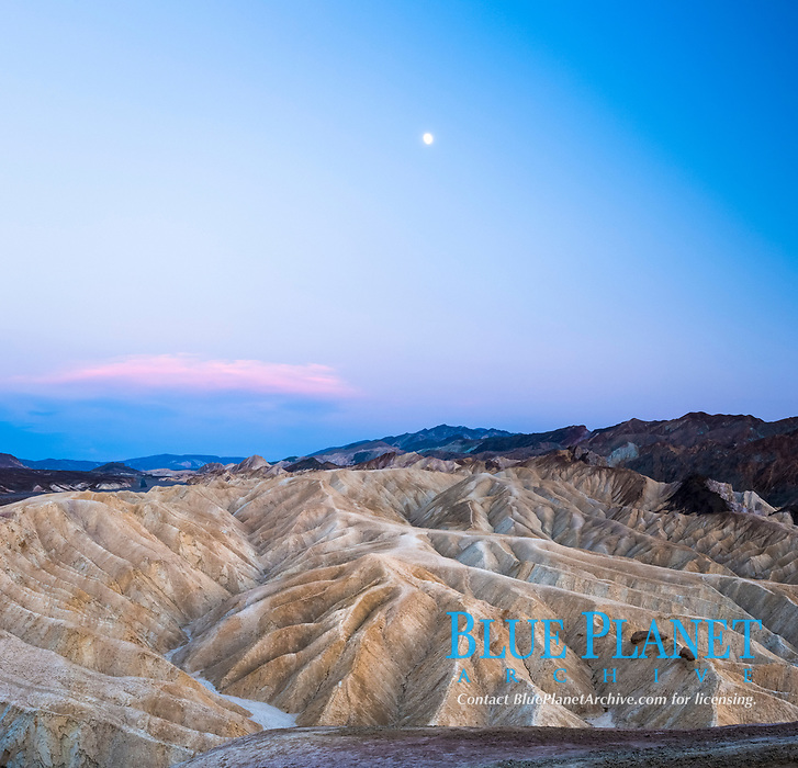 Full moon over Zabriskie Point landscape, Death Valley National Park, California, USA