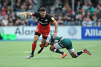 Duncan Taylor of Saracens is tackled by Peter Betham of Leicester Tigers during the Aviva Premiership semi final match between Saracens and Leicester Tigers at Allianz Park on Saturday 21st May 2016 (Photo: Rob Munro/Stewart Communications)