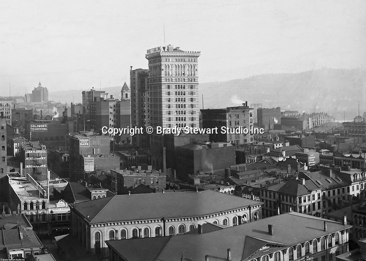 Pittsburgh PA: View of City from the top of the Empire Building. View of the city toward the Monongahela River. <br /> <br /> Arrott Building dominates the skyline. Company signs on the city buildings include: J.R. Weldin & Company Stationery and Engraving, Solomon's Outfitters, The German Fire Insurance Company, and the Peoples Savings Bank