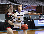 SIOUX FALLS, SD - MARCH 8: Lauren Frost #13 of the Omaha Mavericks drives past Carla Flores #0 of the Western Illinois Leathernecks during the Summit League Basketball Tournament at the Sanford Pentagon in Sioux Falls, SD. (Photo by Richard Carlson/Inertia)
