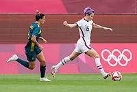 KASHIMA, JAPAN - JULY 27: Megan Rapinoe #15 of the USWNT passes the ball during a game between Australia and USWNT at Ibaraki Kashima Stadium on July 27, 2021 in Kashima, Japan.