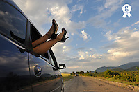 Woman's legs in high heels out of car window (Licence this image exclusively with Getty: http://www.gettyimages.com/detail/90430494 )