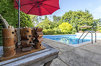 BNPS.co.uk (01202 558833)<br /> Pic: KnightFrank/BNPS<br /> <br /> Pictured: Swimming pool.<br /> <br /> An impressive family home built in an 'industrial scale' oast house with multiple circular rooms is on the market for £1.6m.<br /> <br /> The property is one half of a massive former six roundel oast house that has been expanded and renovated by the current owners.<br /> <br /> Estate agents Knight Frank say the roundels are far larger than normally seen in most oast houses, which means the property has quirky character while also being a practical family home.<br /> <br /> This six-bedroom house is in the picturesque Kent countryside, but just 1.5 miles from the village of Hadlow and ten minutes' drive from the bigger town of Tonbridge.