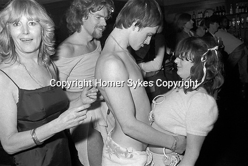 Richard Branson and Mike Oldfield dressed as 'babies' in a fancy dress, Virgin Records company office party at The Venue Victoria London 1978.<br />