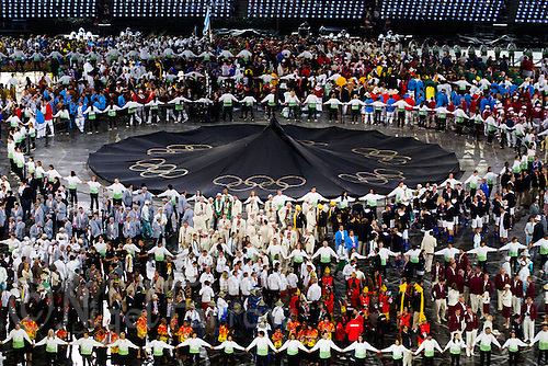 27 JUL 2012 - LONDON, GBR - Competitors wait for the lighting of the Olympic Flame during the Opening Ceremony of the London 2012 Olympic Games in the Olympic Stadium in Stratford, London, Great Britain (PHOTO (C) 2012 NIGEL FARROW)