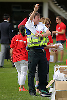 Pictured: A South Wales Police PCSO prepares to take part in Cardiff, Wales, UK. Wednesday 24 August 2016<br /> Re: The largest rugby scrum has been achieved by Golden Oldies at University Fields in Cardiff south Wales, UK. It was refereed by welsh international referee Nigel Owens. Guinness World Records has verified the new record in which 1297 people took part in.