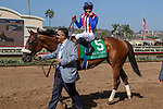 DEL MAR, CA  SEPTEMBER 1:  A jubilant owner, Kaleem Shah, leads his filly #5 Bellafina, ridden by Flavien Prat, into the winners circle after winning Del Mar Debutante (Grade 1) on September 1, 2018, at Del Mar Thoroughbred Club in Del Mar, CA.(Photo by Casey Phillips/Eclipse Sportswire/Getty ImagesGetty Images