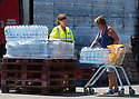 02/07/18<br /> <br /> People load-up with supplies of emergency water bottles from a lorry supplied by Severn Trent Water, in Ashbourne, Derbyshire. Nearby villages are experiencing interrupted water supplies as heavy demand for water puts a huge demand on the network.<br /> <br /> All Rights Reserved, F Stop Press Ltd. (0)1335 344240 +44 (0)7765 242650  www.fstoppress.com rod@fstoppress.com