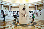Portraits of Pokerstars Team Pros in the rotunda outside the tournament area.