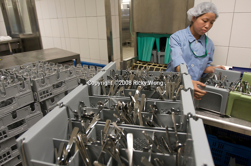 Staff work in the Beijing Air Catering Co. Ltd. The company was the first China's joint venture enterprise during the economic reform in 1980..