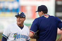 September 1, 2009:  Everett AquaSox manager John Tamargo gives home plate umpire Gary Coy a piece of his mind during a Northwest League game against the Vancouver Canadians at Everett Memorial Field in Everett, Washington.