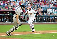 May 30, 2011; Phoenix, AZ, USA; Arizona Diamondbacks base runner Justin Upton scores in the third inning against the Florida Marlins at Chase Field. Mandatory Credit: Mark J. Rebilas-