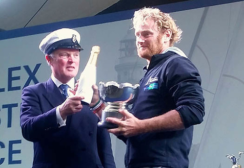 Ronan O Siochru of Irish Offshore Sailing receiving the Roger Justice Trophy and some much-needed refreshment from RORC Commodore Michael Boyd of Dun Laoghaire at the 2015 Fastnet Race prize-giving in Plymouth