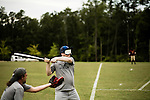 July 25, 2008. Durham, NC.. Started over 30 years ago, Beep Ball is baseball for the visually impaired. Played with an oversized softball that beeps, and bases that also make sound, the game has allowed people with varying degrees of visual impairment to participate in a team sport. All players are required to wear blacked out masks, to equalize the impairment and if the fielding team gets control of the ball before the hitting player reaches the base, an out is recorded. If the hitting player reaches the base first, a run is scored. There are only 2 bases, one to the left and one to the right, and the hitting player hears a tone after the hit is made, to add to the difficulty, telling them which base to run to..  Joe Brouchard, of the Durham Sluggers, prepares to take a pitch.