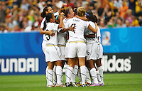USA's players celebrate after scoring 2:0 during the FIFA U20 Women's World Cup at the Rudolf Harbig Stadium in Dresden, Germany on July 17th, 2010.