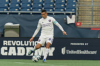 FOXBOROUGH, MA - AUGUST 7: Mateo Rodas #63 of Orlando City B passes the ball during a game between Orlando City B and New England Revolution II at Gillette Stadium on August 7, 2020 in Foxborough, Massachusetts.