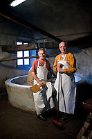 Olive oil extraction, Moulin a Huile, Entrevaux, Alpes de Haute Provence, France, Wednesday 24th February 2010. Yves and Jean-Claude are brothers. Now retired, they run the olive oil mill as volunteers.