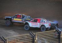 Dec. 10, 2011; Chandler, AZ, USA;  LOORRS pro 2 unlimited driver Greg Adler (10) and Rodrigo Ampudia (36) during round 15 at Firebird International Raceway. Mandatory Credit: Mark J. Rebilas-