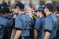 The Cincinnati Bearcats huddle up prior to their game against the Wake Forest Demon Deacons at Wake Forest Baseball Park on February 21, 2014 in Winston-Salem, North Carolina.  The Bearcats defeated the Demon Deacons 5-0.  (Brian Westerholt/Four Seam Images)