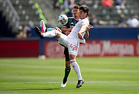 CARSON, CA - APRIL 25: Daniel Steres #5 of the Los Angeles Galaxy and Brian White #42 of the New York Red Bulls battle for a ball during a game between New York Red Bulls and Los Angeles Galaxy at Dignity Health Sports Park on April 25, 2021 in Carson, California.