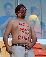 An England fan with 'God Save the Queen' painted on his chest