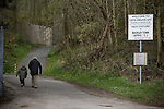 Cefn Druids AFC 1 Buckley Town 0, 12/04/2014. The Rock, Cymru Alliance league. A man and boy walking towards The Rock, Rhosymedre, home to Cefn Druids AFC, prior to the club's final home game of the season against Buckley Town in the Cymru Alliance league. Druids, reputedly the oldest football club in Wales, won the Alliance league the previous week and were awarded the trophy after the Buckley Town match, which they won by 1 goal to nil, watched by a crowd of 246. The Cymru Alliance was the second tier of Welsh football based in north and mid Wales, promotion from which led directly into the Welsh Premier League. Photo by Colin McPherson.